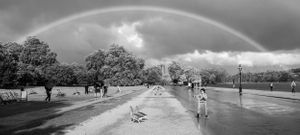 Black and white photo of a rainbow over Hyde Park.