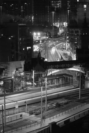 Black and white long exposure Street Photograph of Deansgate station, Manchester.