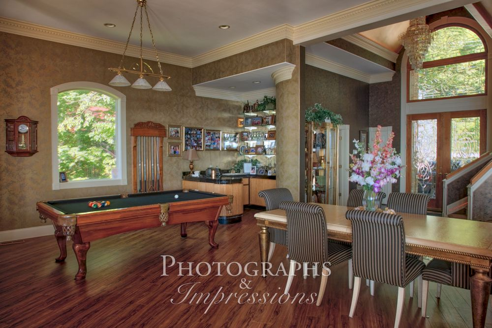 real estate photograph of destiny chalet pool table by Photographs and Impressions and Nunweiler Photography