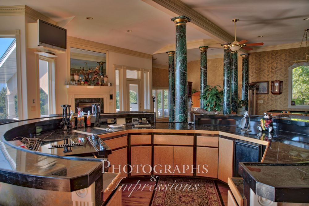 real estate photograph of destiny chalet kitchen bar by Photographs and Impressions and Nunweiler Photography