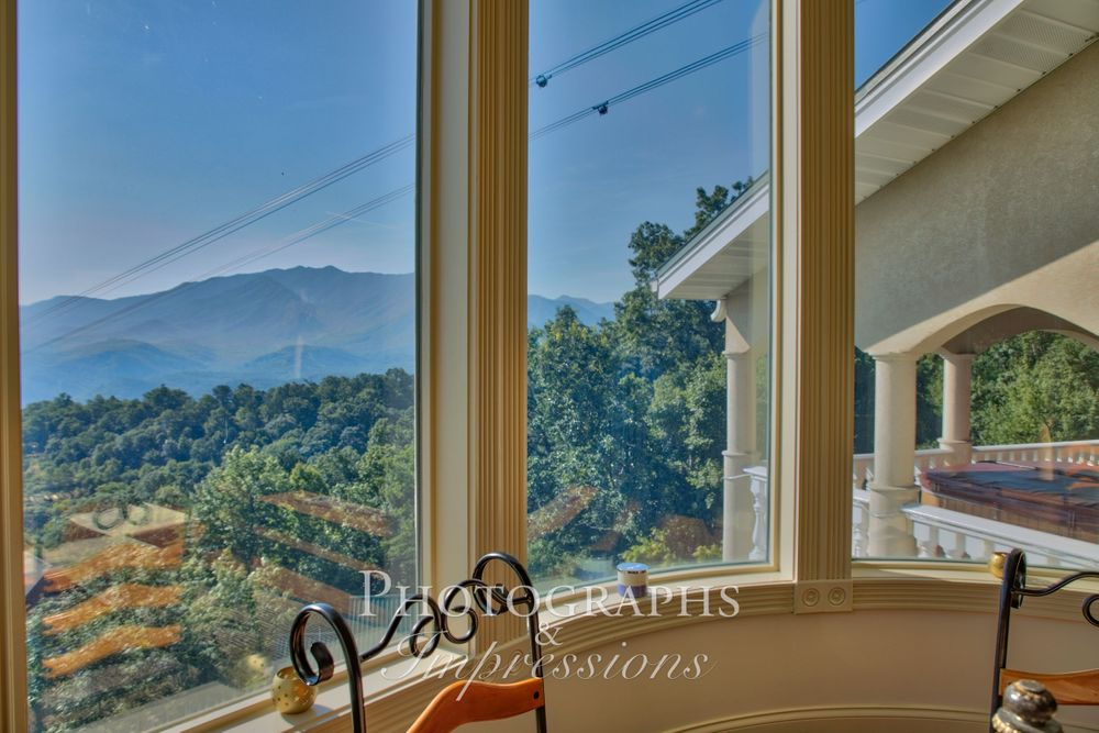real estate photograph out bay window by Photographs and Impressions and Nunweiler Photography