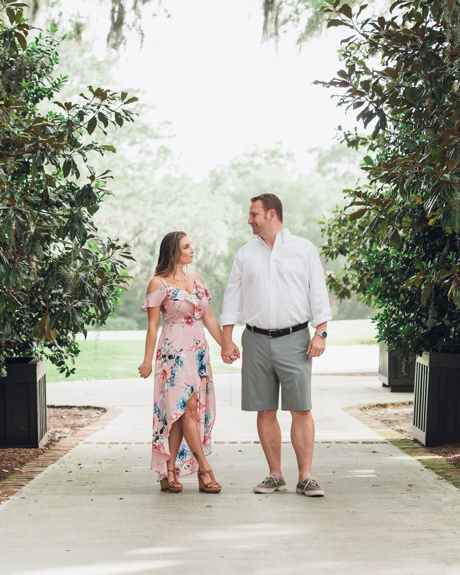 Bride & groom to be looking at each other during engagement session at Caledonia Golf & Fish Club, Pawleys Island