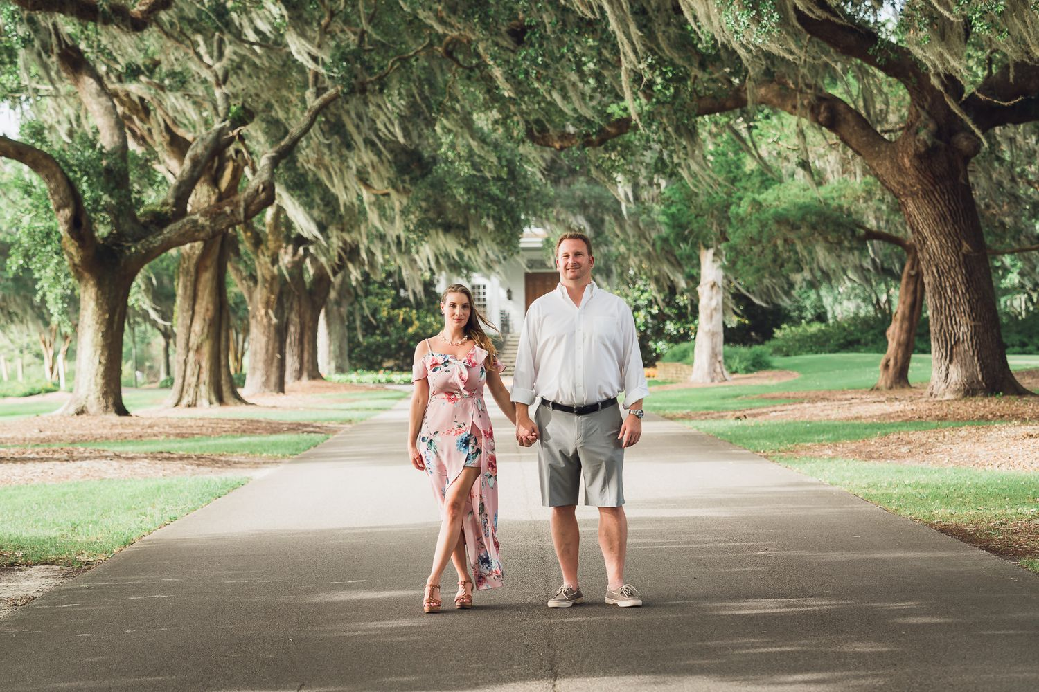 Future bride & groom holding hands during their engagement photoshoot at Caledonia Gold & Fish Club, Pawleys Island, SC
