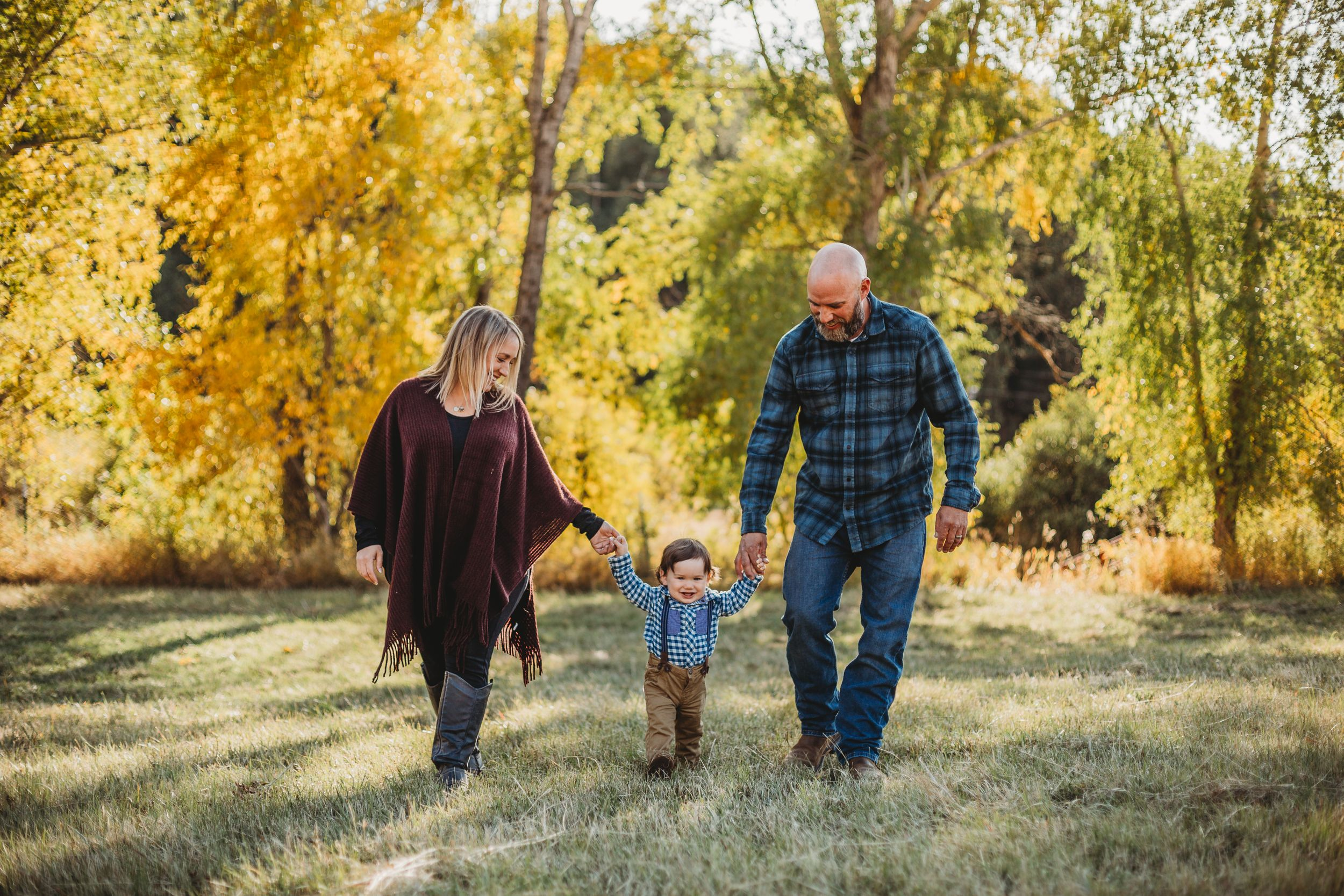 Family walks through the Rocky Mountains during their Family Session in Fort Collins, Colorado.