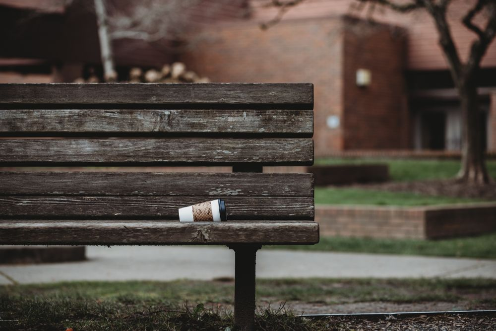 coffee cup left on park bench