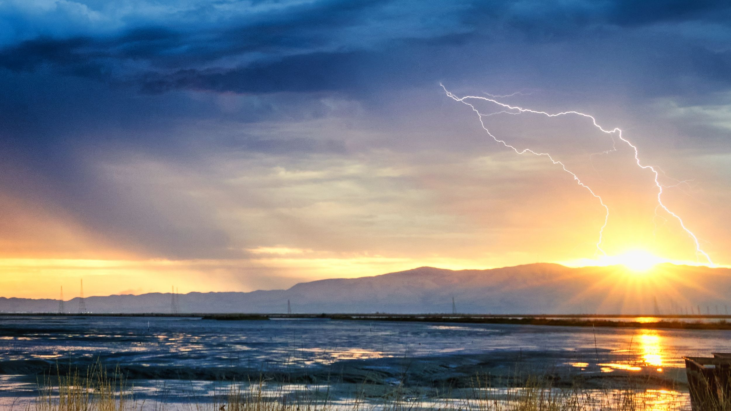 Rare thunderstorm in the Bay Area at sunrise, viewed from the Palo Alto Baylands