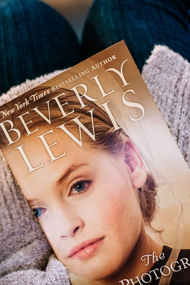 Photo a day image of a woman reading a book by Beverly Lewis called The Photograph