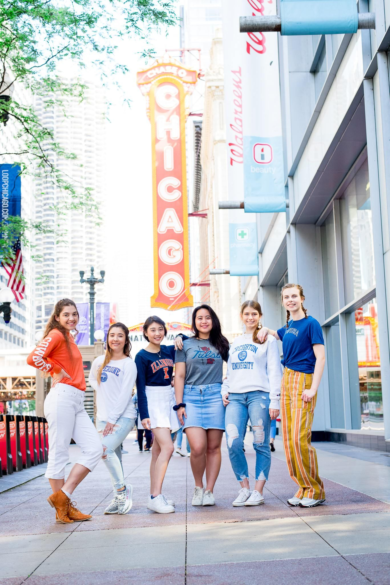 six senior girls in front of the Chicago Theater sign for Chicago senior pictures