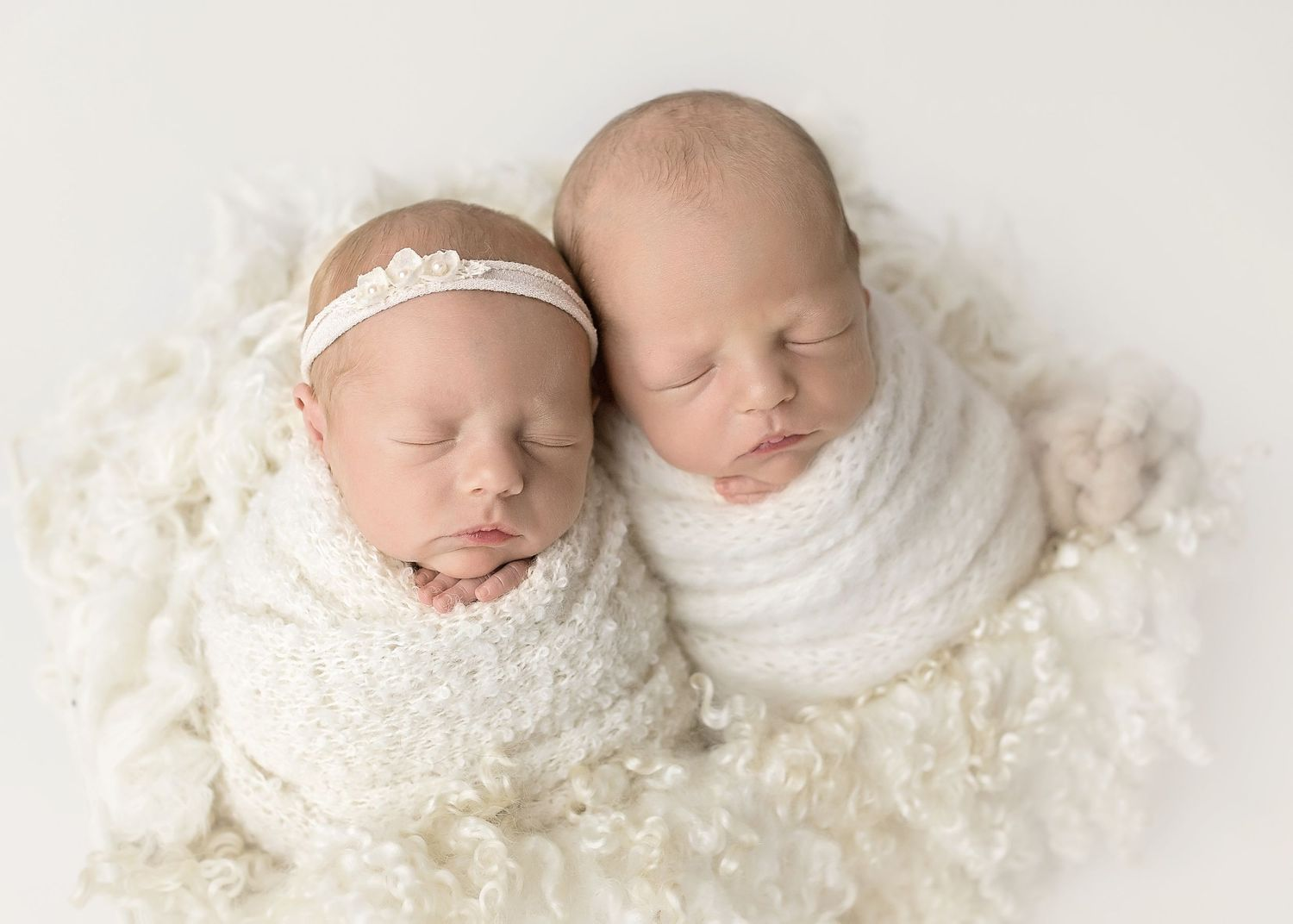 newborn twins snuggling