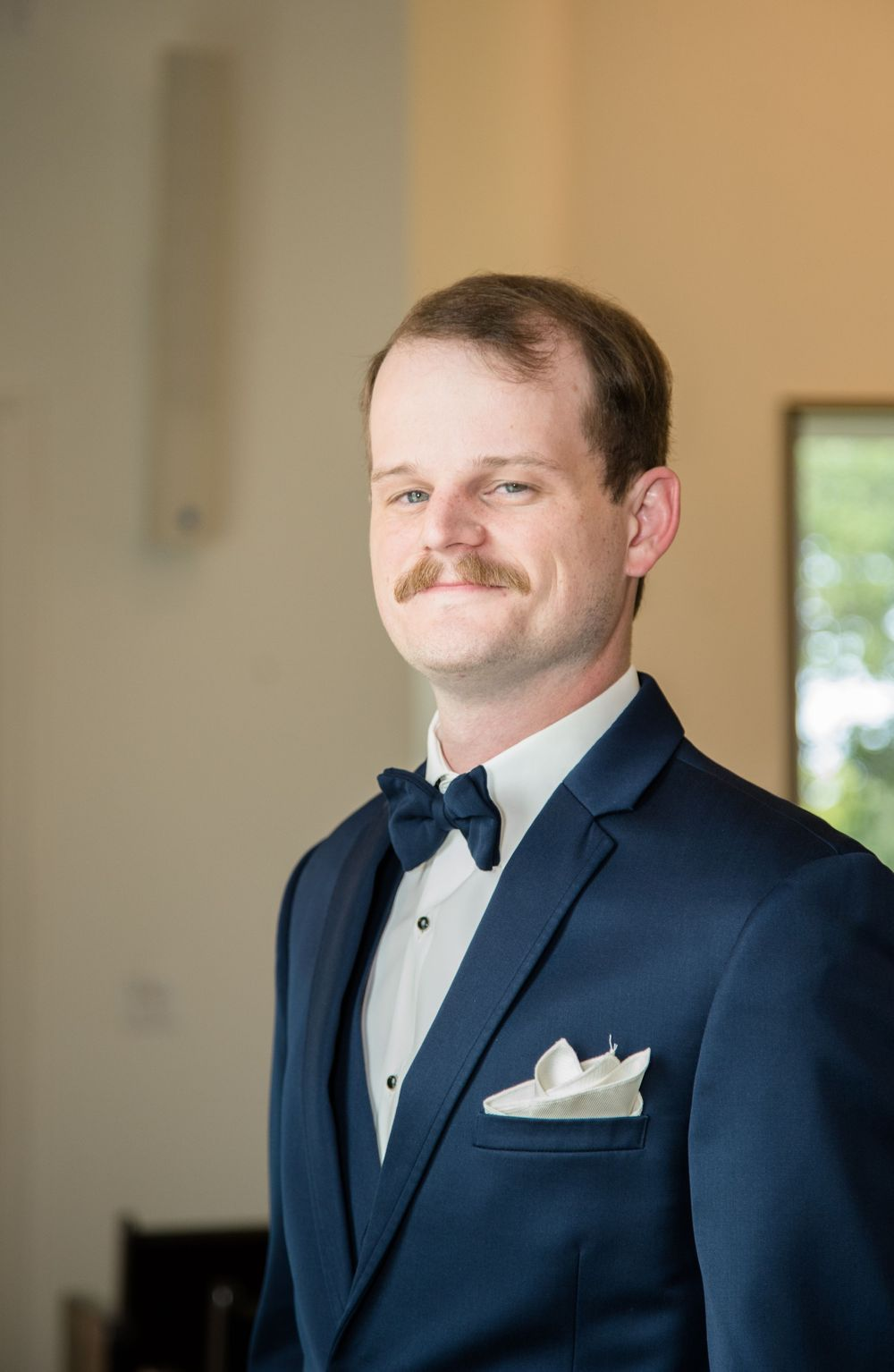 Groom portrait inside wedding chapel at one preston events in gunther texas