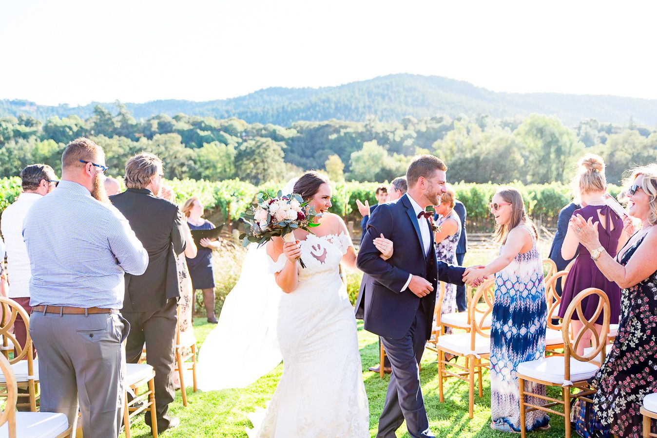 bride and groom walk through guests after getting married on Pennyroyal Farm in Anderson valley