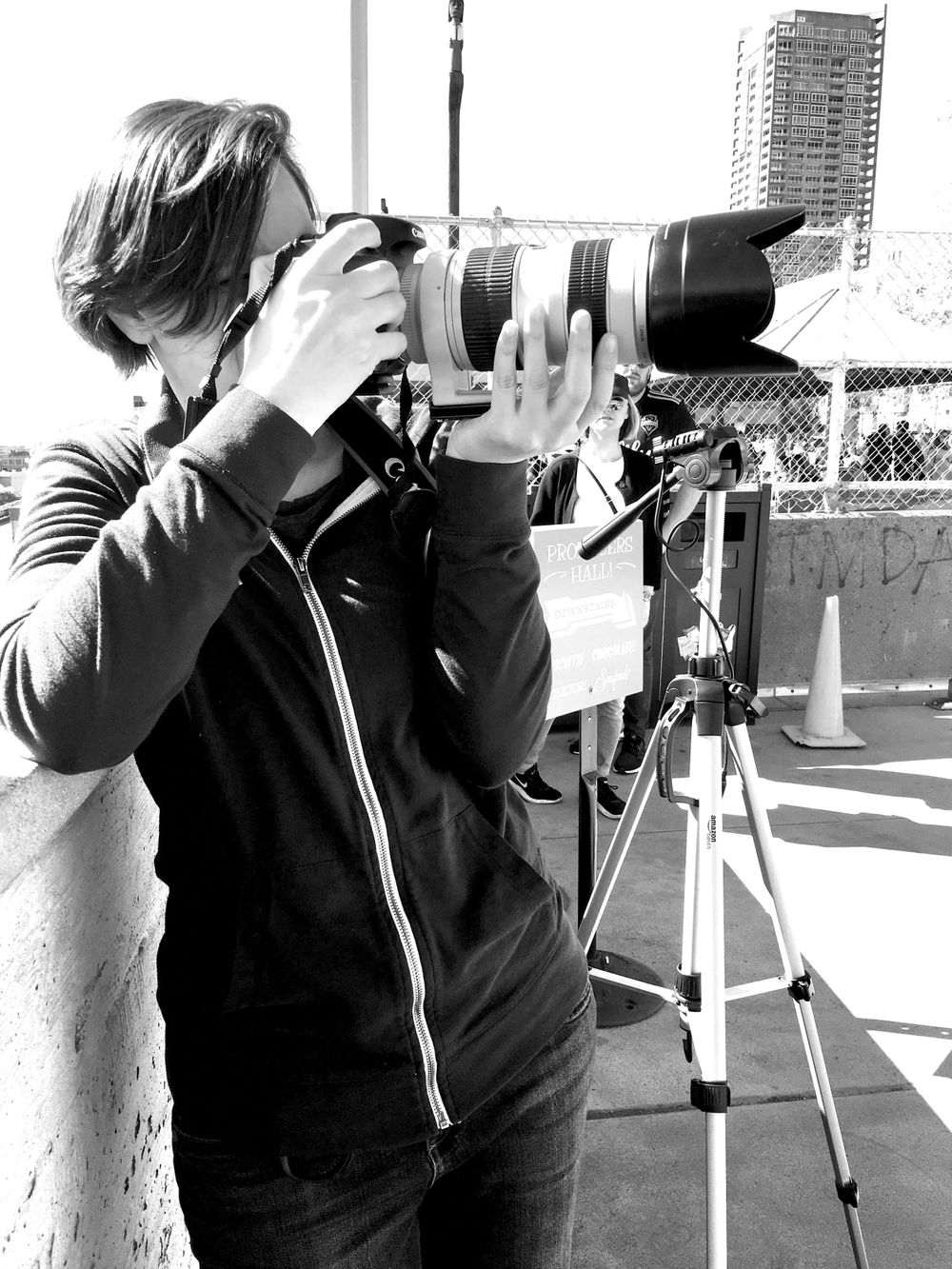 Photographer Shaya Lyon shooting on location at the Pike Place Market in Seattle.