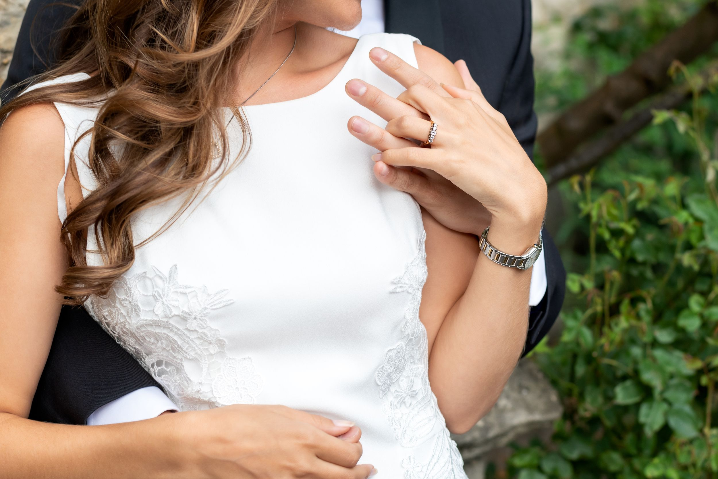 Wedding couple embracing and holding hands