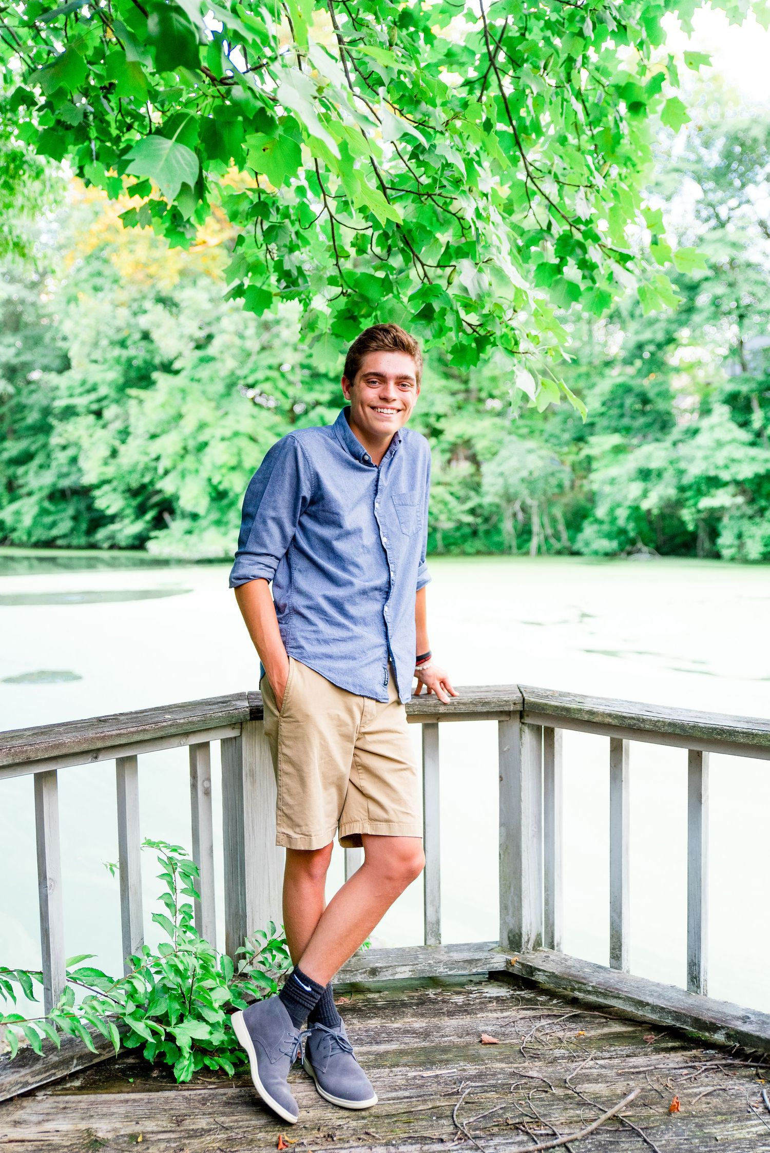 teenage boy, family photos, standing on balcony, pond, outdoors, summer, Cincinnati OH