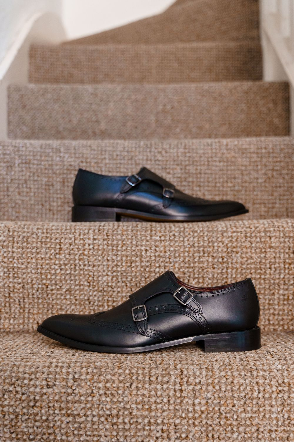 Men's black wedding shoes on a staircase - Hampshire wedding photography