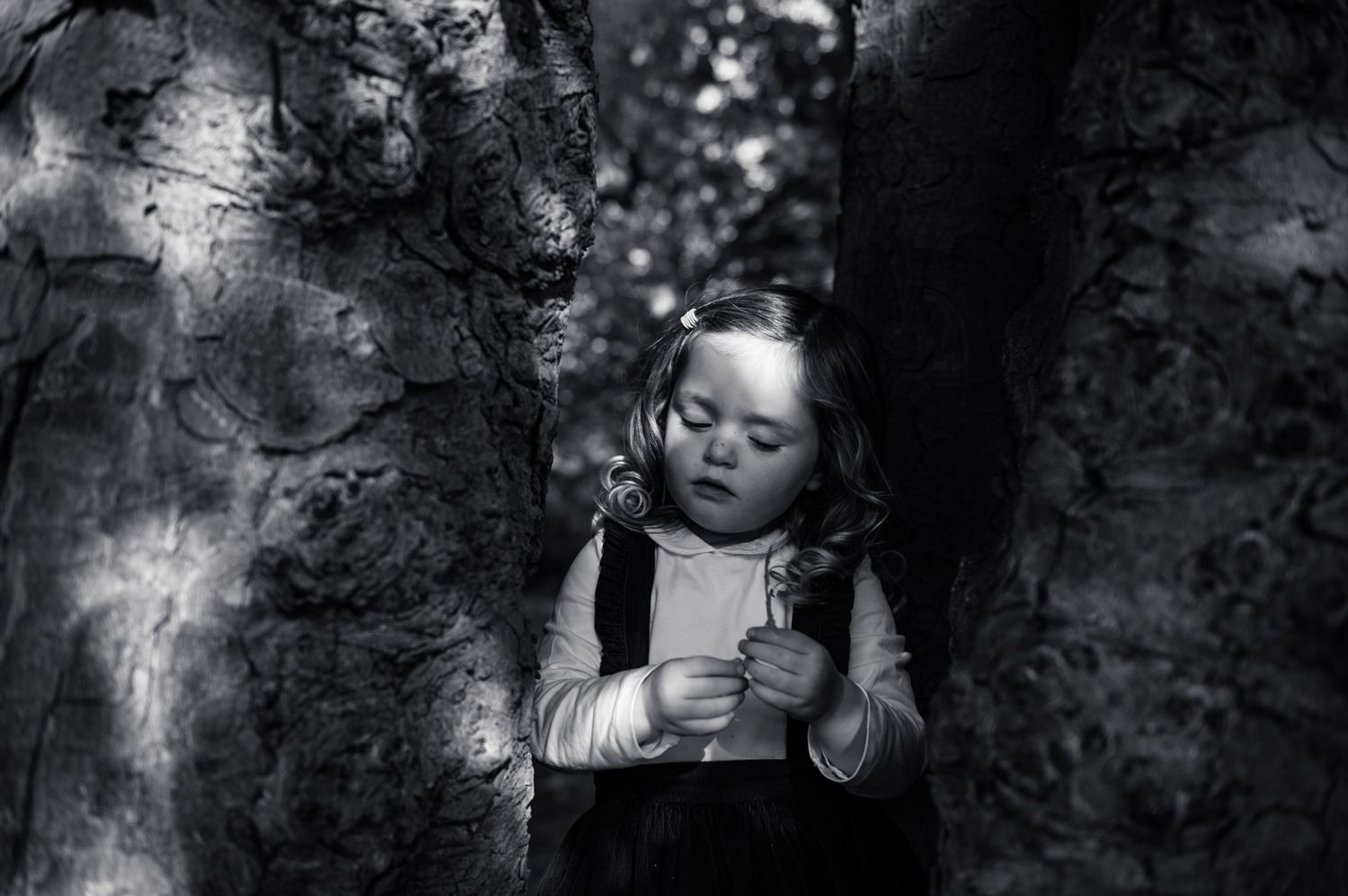 black and white photograph of girl in sunlight
