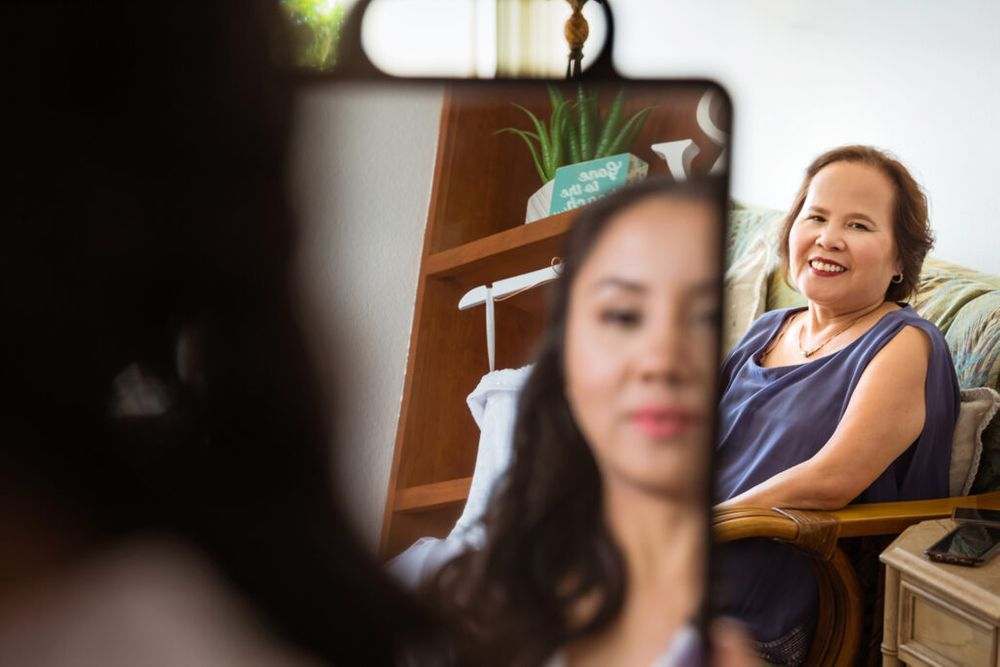 mom watches bride get makeup done