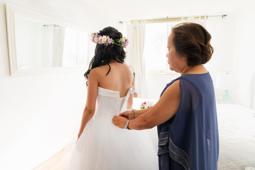 bride helps with dress