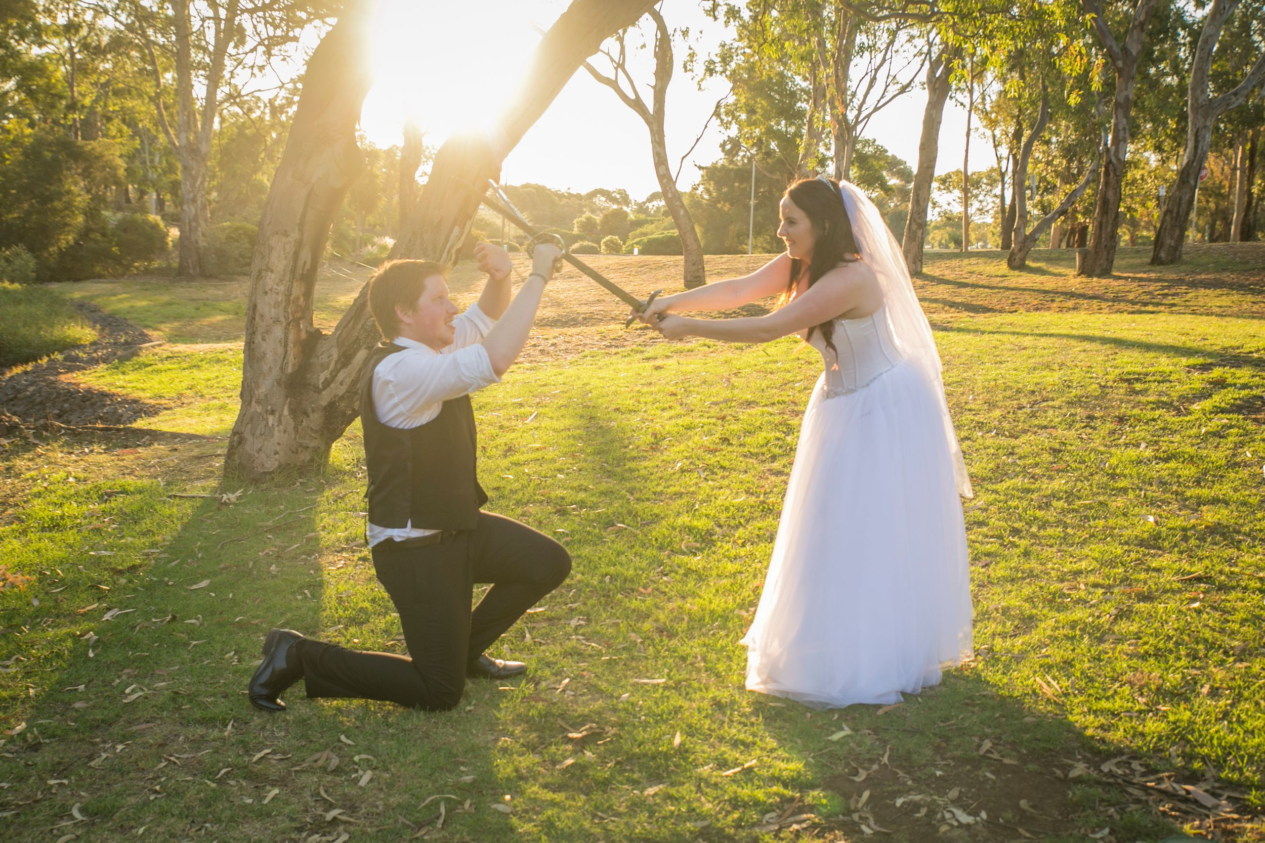 bride and groom sword fighting geelong wedding photographer