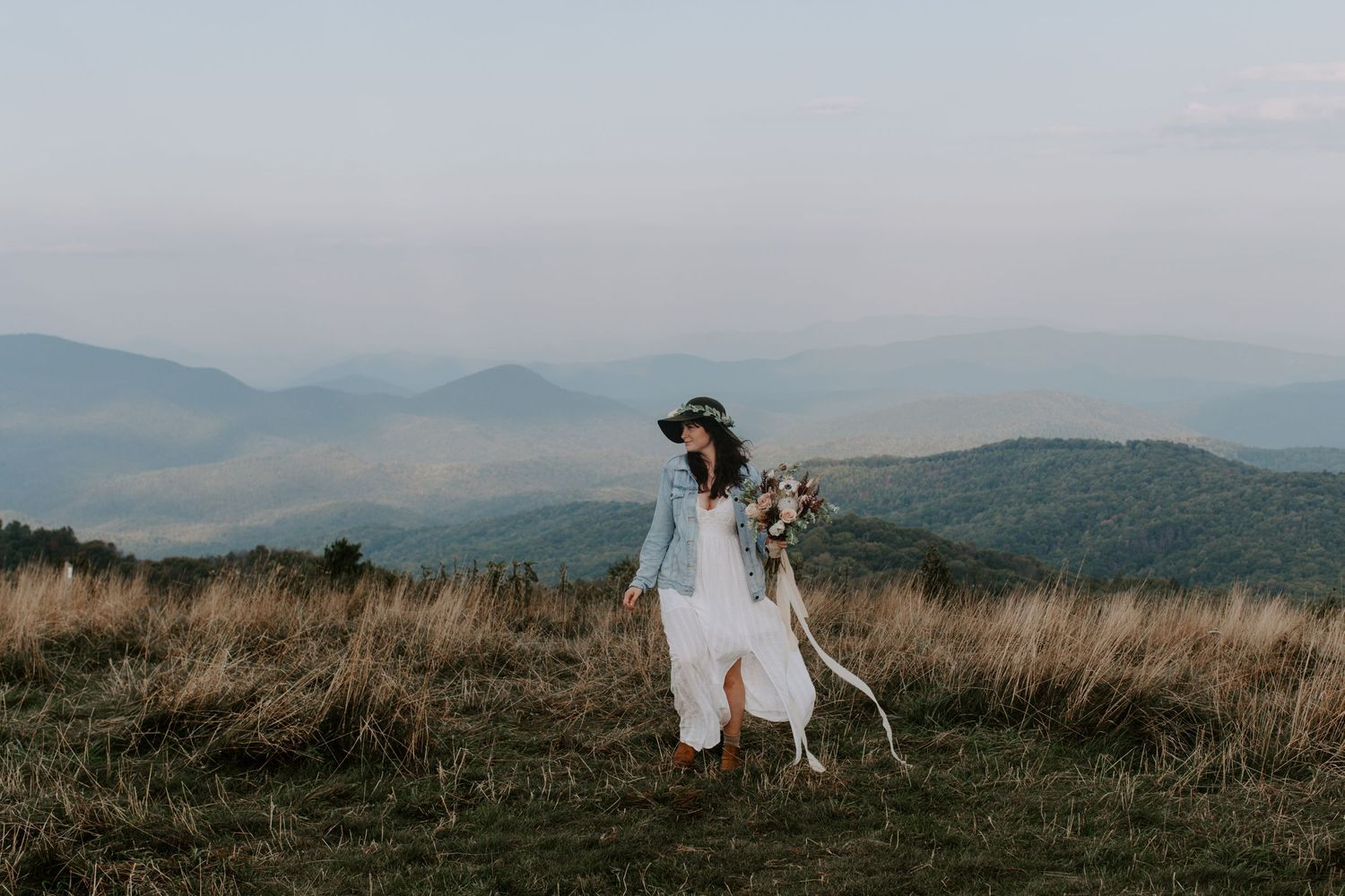 Woman walking holding a bridal bouquet during her North Carolina adventurous elopement