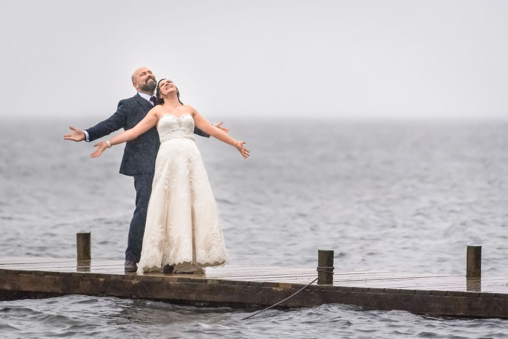 Newlyweds embrace storm at elopement wedding in Lake District