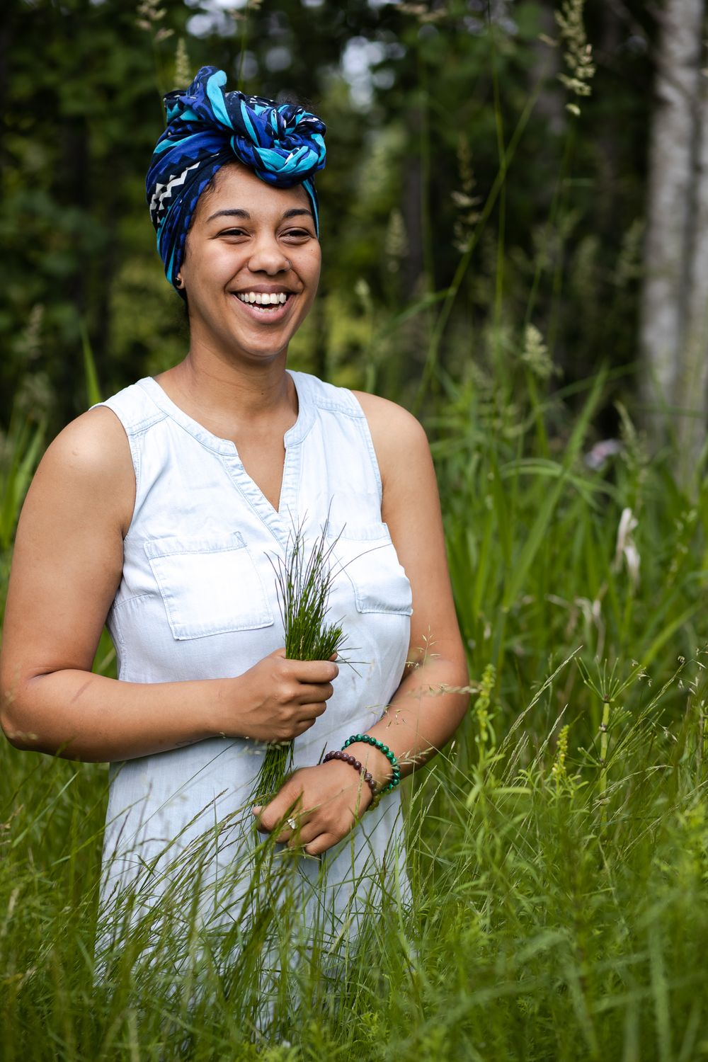 PNW Apothecary black female owner smiling after harvesting horsetail