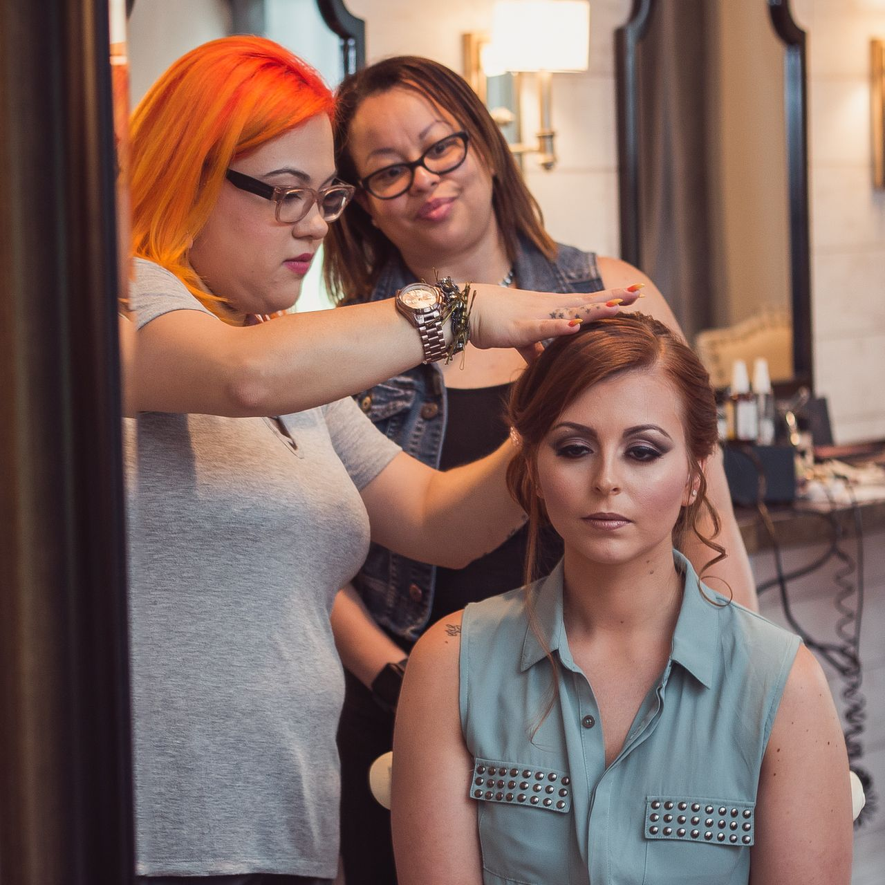 woman having professional hair and make up done