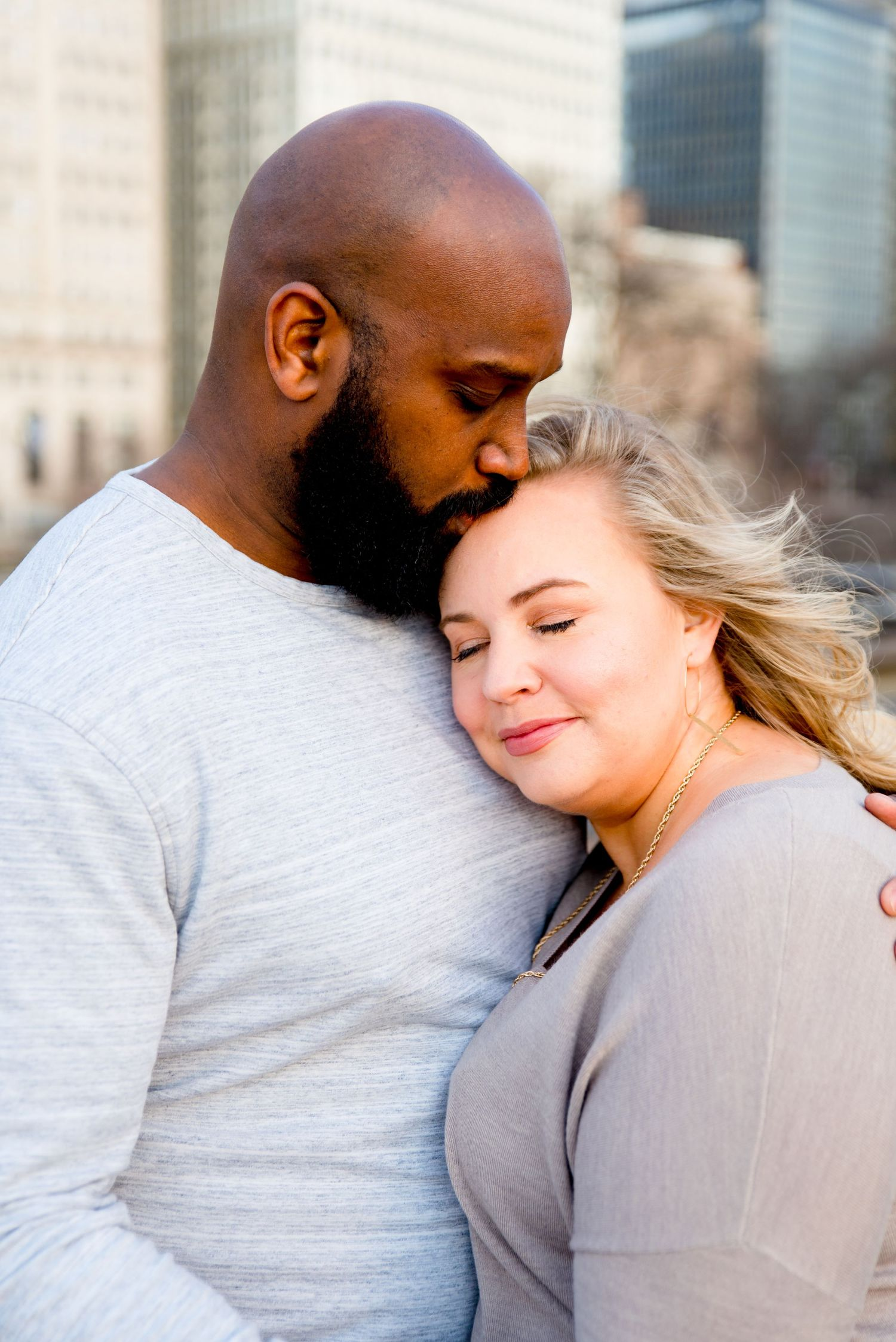 man kissing his fiance on forehead for Chicago sunrise engagement photos
