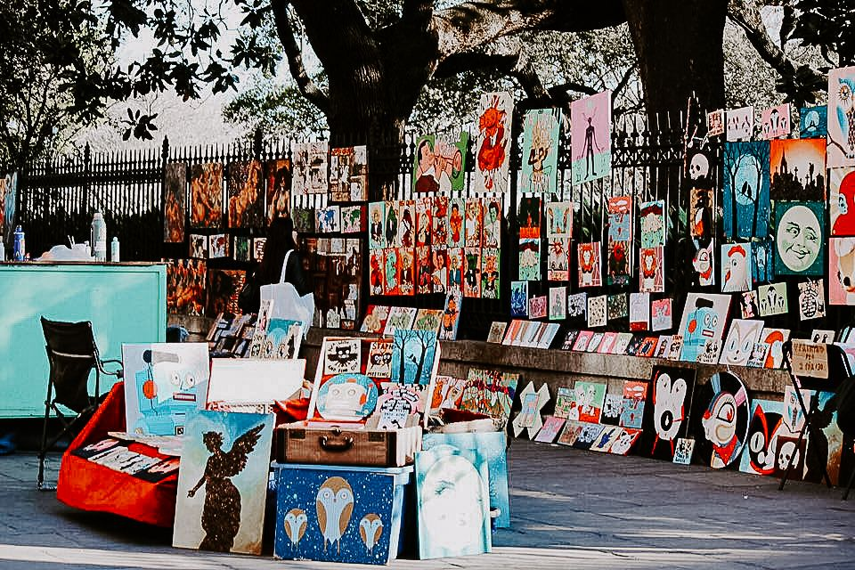 a mass of colorful art pieces in Jackson Square French Quarter New Orleans French Quarter Elopement