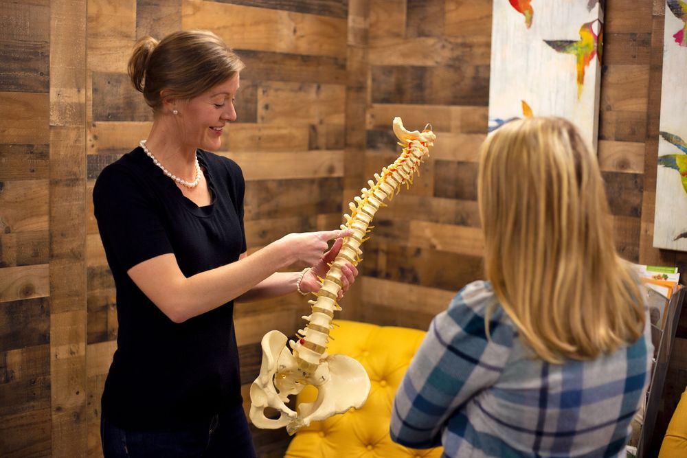 Spinal review with client at Chiropractic & Health in Farmington