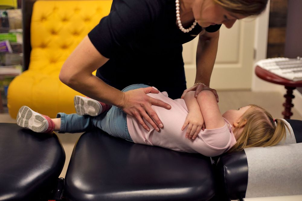 Back adjustment for child at Chiropractic & Health in Farmington Utah