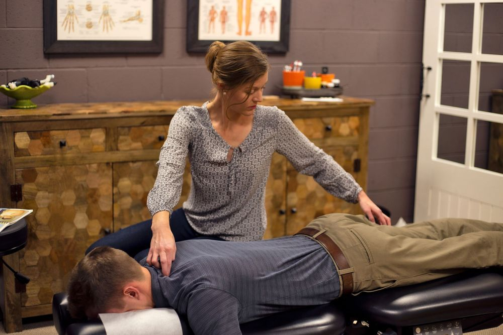 Focus points on the body of male client Chiropractic & Health in Farmington Utah