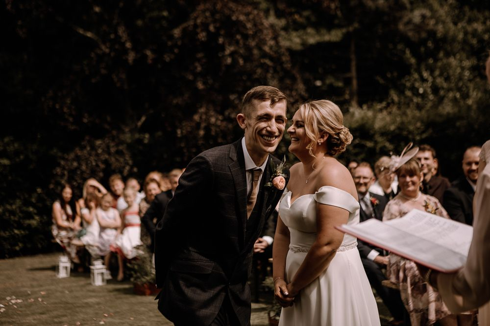 Bride and groom laughing during celebrant wedding ceremony, wedding photography by Esme Whiteside Photography