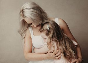 a beautiful moment with a mother and daughter hugging and smiling