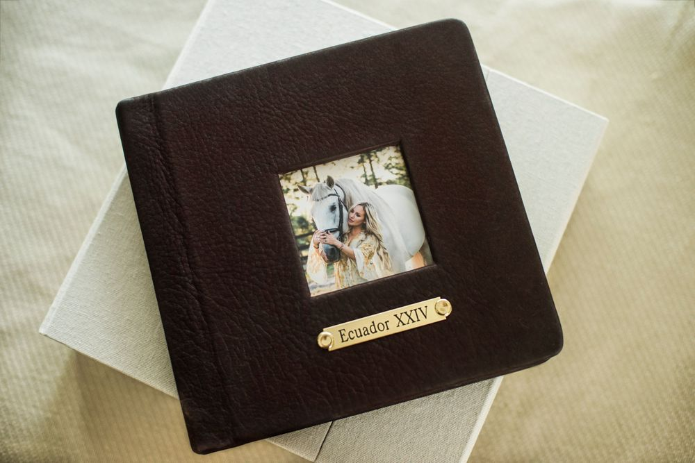 Chocolate brown album with gold name plate and square photo of white horse and blonde girl