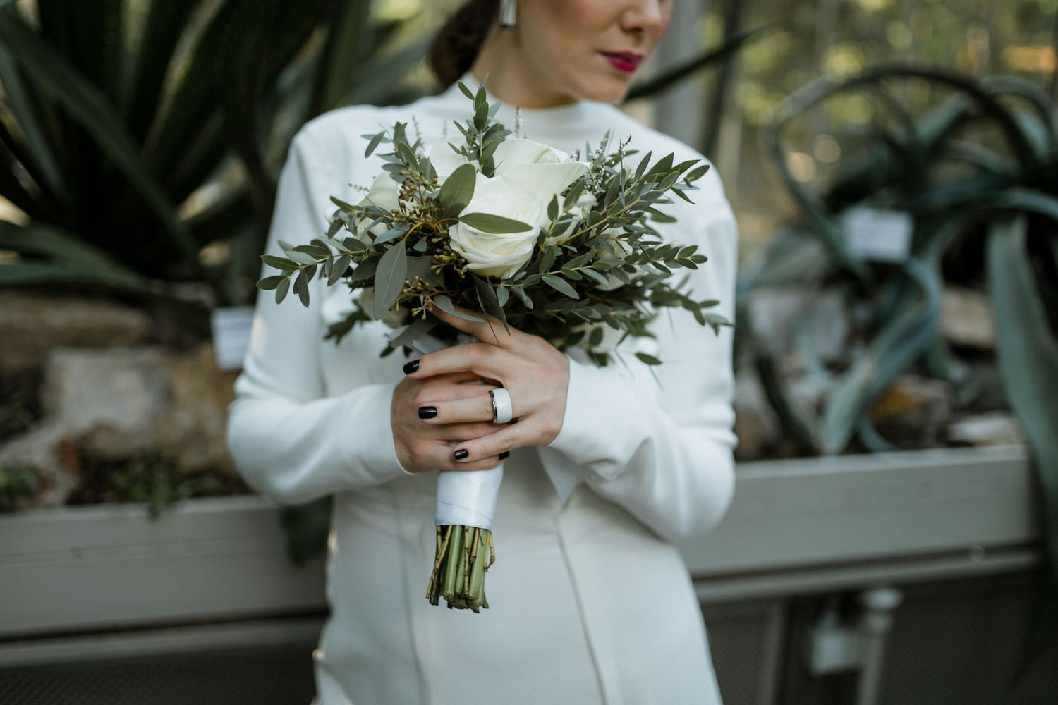 Bride holding a white and green bridal bouquet