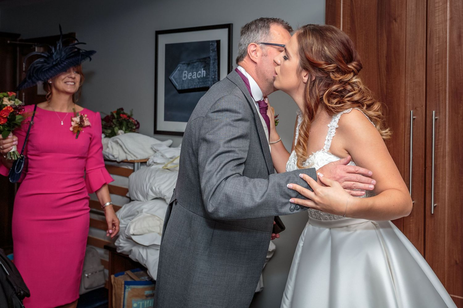 bride kisses her father on the cheek after seeing her for the first time in her dress