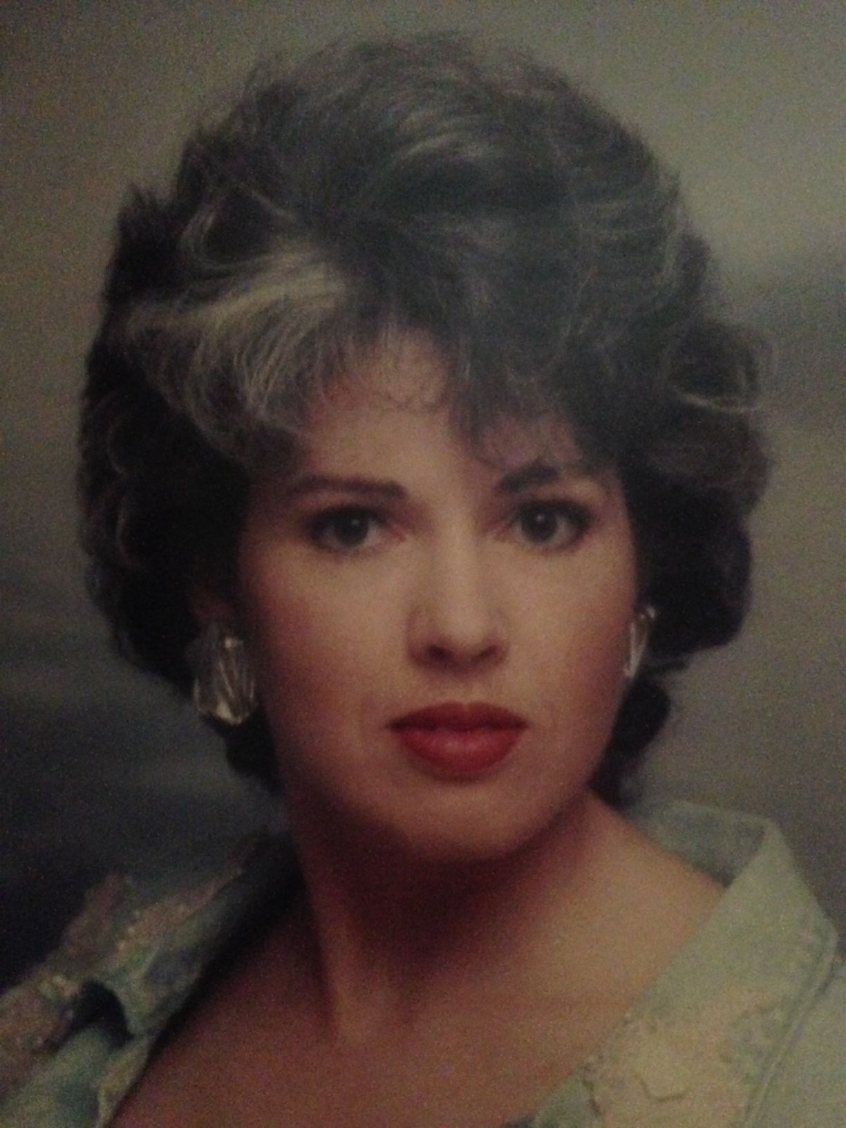 retro portrait of salt and pepper haired woman