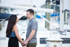 Downtown Annapolis Couple against Sailboat Backdrop | Engagement Photography | Date Night Sessions | DANIE Photography