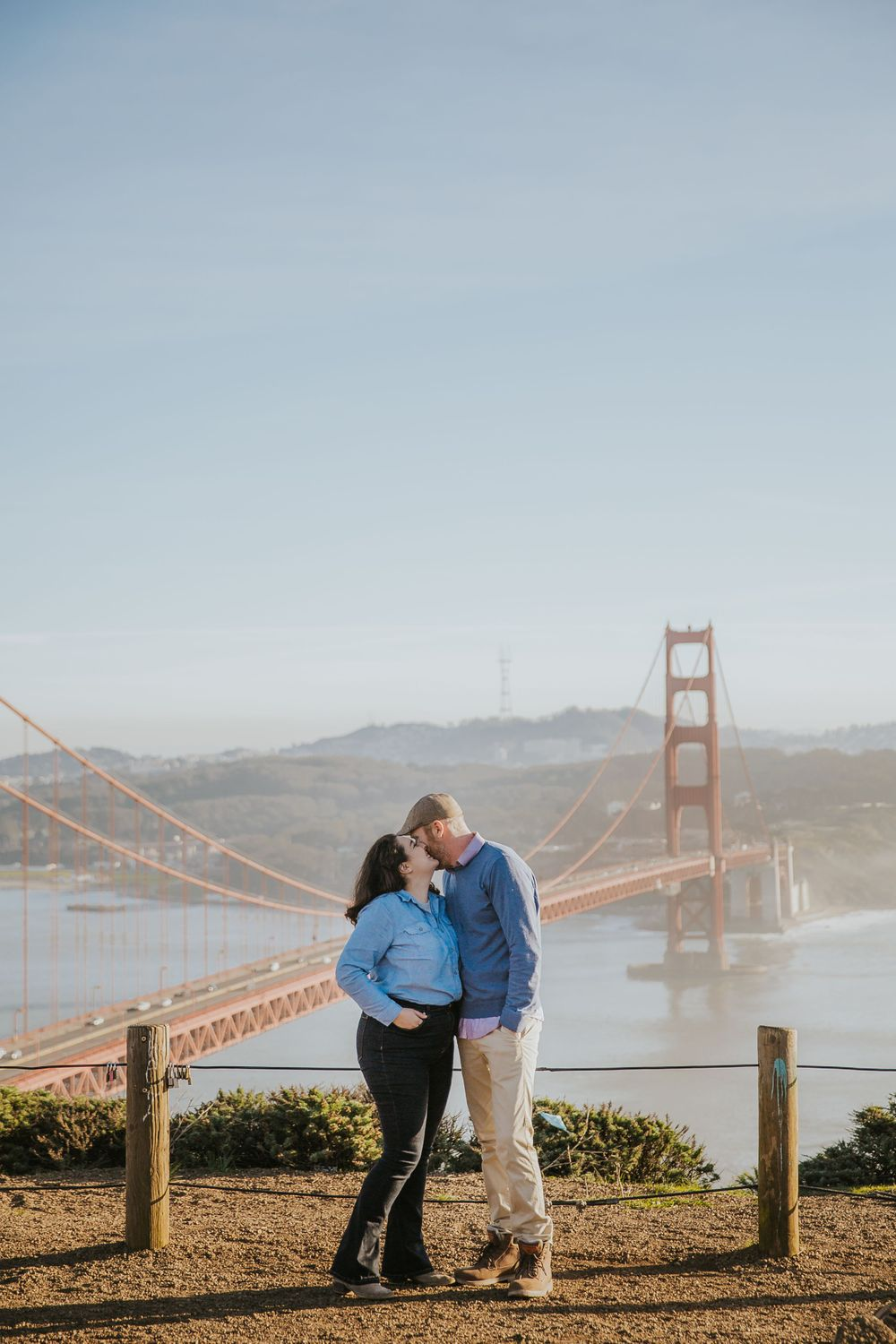 rebecca skidgel photography engagement session in marin headlands couple kissing in front of golden gate bridge