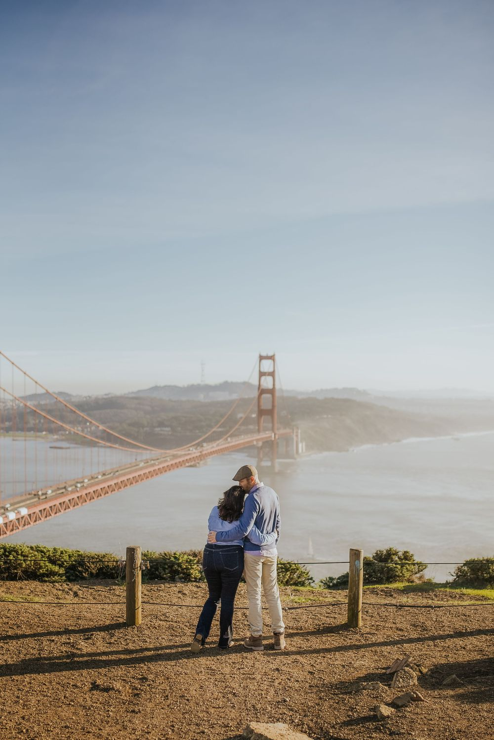 rebecca skidgel photography engagement session in marin headlands couple hugging in front of golden gate bridge