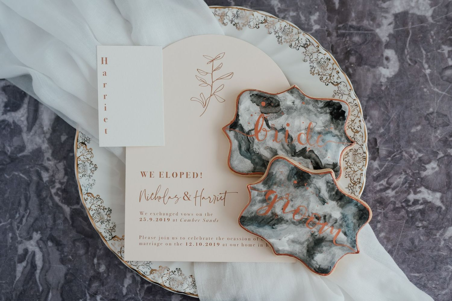 Marble effect iced wedding biscuits and cream wedding stationery