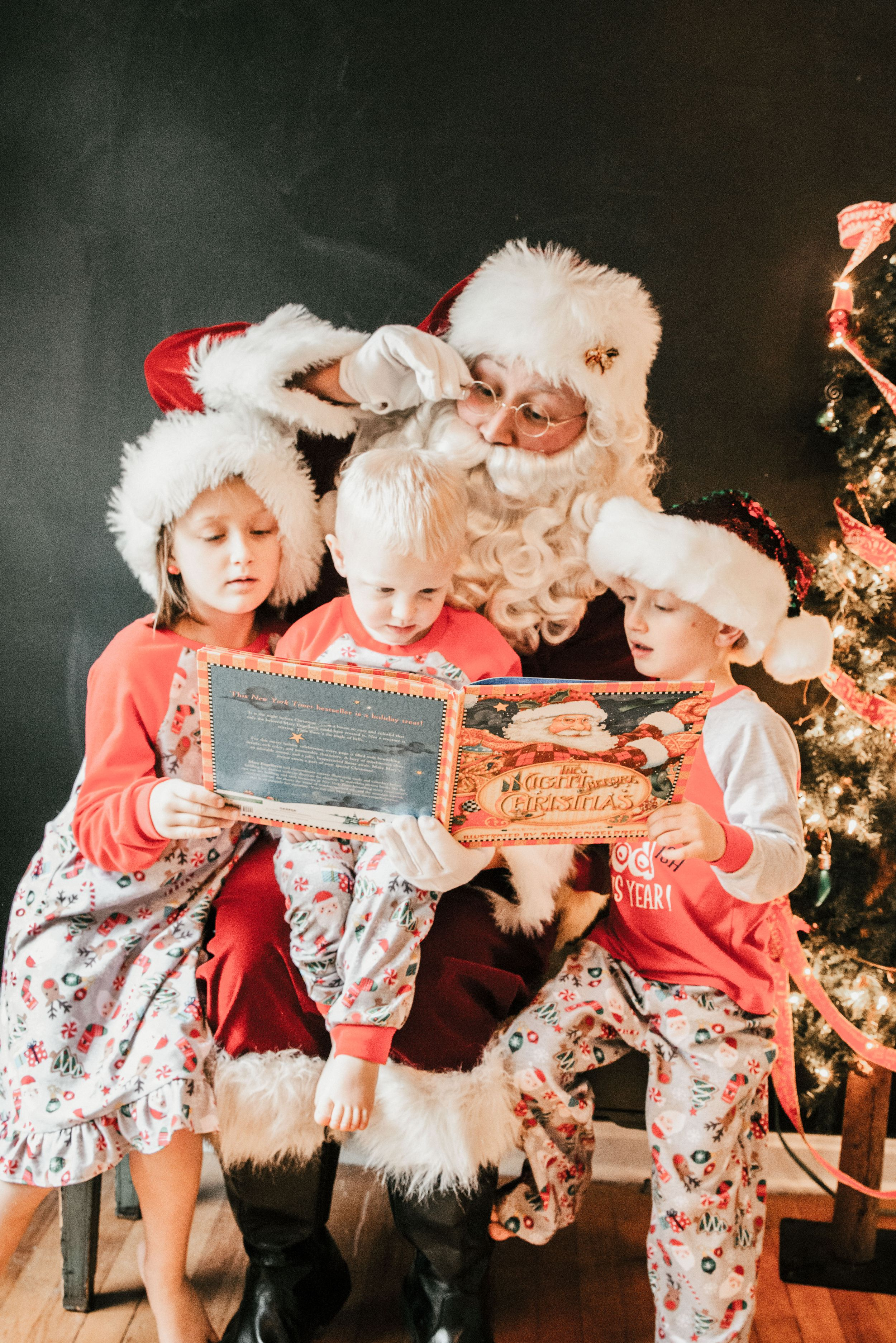 Santa reading to children in Christmas pajamas, Shiny Penny Studios, Cleveland