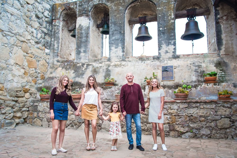 Photo of a family at the Mission San Juan Capistrano in San Juan Capistrano, CA