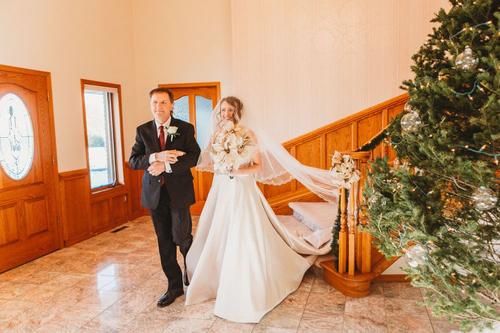 Bride walks down the aisle with her father during her Loveland, Colorado wedding.