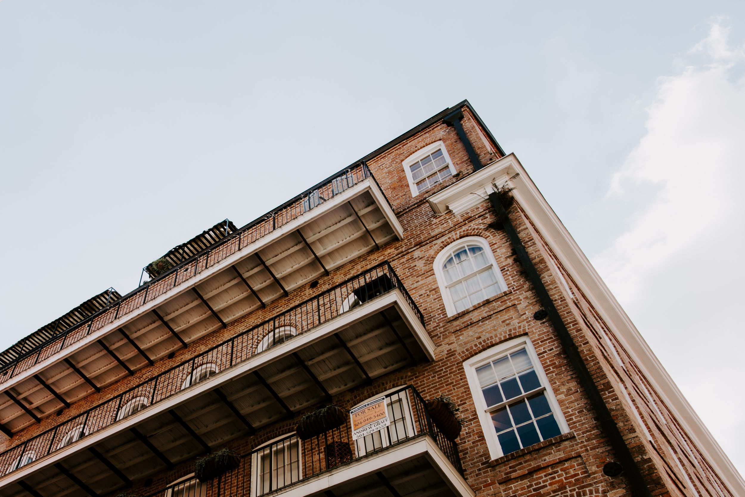 Looking up view of a building in the French Quarter, urban elopement