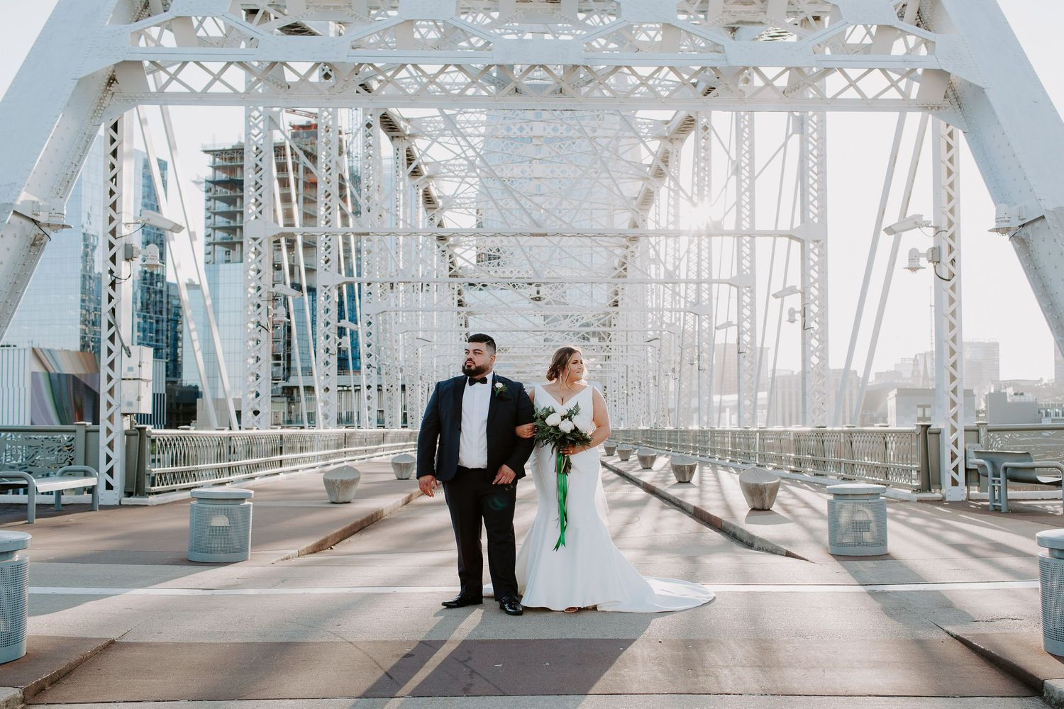 couple holding hands on the Pedestrian bridge during their downtown Nashville elopement