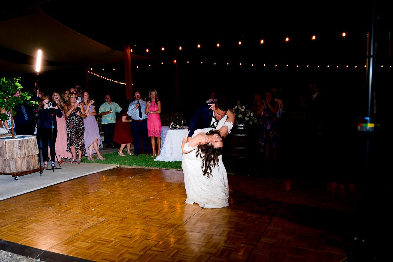 bride and groom dance and dip on reception floor