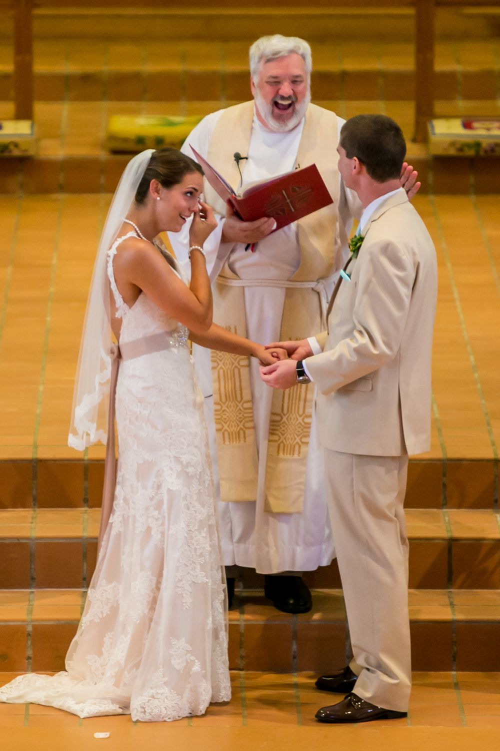 Alex and Mike exchange vows during their wedding ceremony at Incarnation Lutheran Church in Columbia, SC.