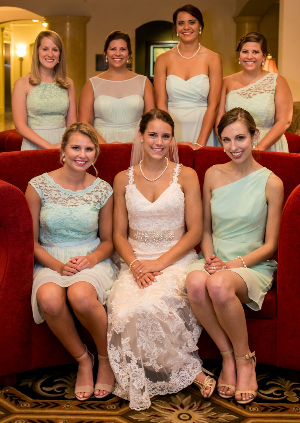 Bride Alex and her bridesmaids sit on a couch before a wedding ceremony at Incarnation Lutheran Church in Columbia, SC